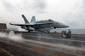 An F/a-18 Hornet Strike Fighter Assigned To The  Valions  Of Strike Fighter Squadron Fifteen (vfa-15) Prepares For Launch Image
