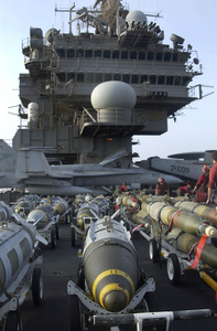 Assorted Bombs Are Raised To The Flight Deck On Elevators Aboard Uss Constellation (cv 64). Image