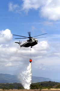 A Ch-53d Sea Stallion Assigned To Marine Heavy Helicopter Squadron Four Six Three (hmh-463) Performs Fire Fighting Drills Image