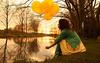 Girl Holding Balloons Image