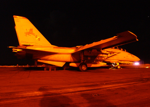 An F-14 Tomcat Assigned To The  Black Lions  Of Fighter Squadron Two One Three (vf-213) Prepares To Launch From The Flight Deck Aboard The Aircraft Carrier Uss Theodore Roosevelt (cvn 71). Image