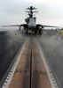 An F-14d Tomcat Assigned To The Tomcatters Of Fighter Squadron Three One (vf-31) Sits Poised For Launch On One Of Four Steam-powered Catapults Aboard The Nuclear Powered Aircraft Carrier Uss John C. Stennis (cvn 74). Image