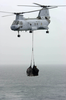A Ch-46 Sea Knight Transfers Cargo Image