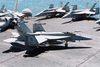 An F/a-18c Hornet Assigned To The Eagles Of Strike Fighter Squadron One One Five (vfa 115) Taxies To One Of Four Catapults Image