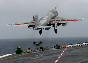 An Ea-6b Prowler Assigned To The Outlaws Of Electronic Attack Squadron One Forty One (vaq-141) Launches From One Of Four Catapults On The Flight Deck Aboard Uss Theodore Roosevelt (cvn 71) Image