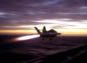 The Afterburners Of An F/a-18f Super Hornet Light The Sky Image