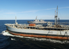The Arleigh Burke-class, Guided Missile Destroyer Uss Ross (ddg 71), Steams Through The Baltic Sea While The British Oiler Rfa Orange Leaf (a 110) Conducts Underway Replenishment With The Aegis Class, Guided Missile Cruiser Uss Vella Gulf (cg 72) Image