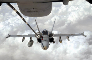 A U.s. Navy F/a-18 Hornet Strike Fighter Flying Missions In Operation Iraqi Freedom Receives Fuel From A Kc-10 Extender. Image