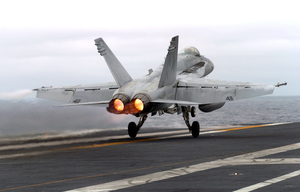 An F/a-18c Hornet Assigned To The Fist Of The Fleet Of Strike Fighter Squadron Two Five (vfa-25) Goes To Full Afterburner As It Performs A Touch-and-go Landing Aboard The Nuclear Powered Aircraft Carrier Uss John C. Stennis (cvn 74). Image