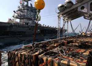 Equipment And Supplies Sit Staged Aboard The Fast Combat Support Ship Uss Detroit (aoe 4), In Preparation For Transfer To The Nuclear Powered Aircraft Carrier Uss Enterprise (cvn 65). Image