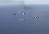 F/a-18e Superhornets Fly In A Diamond Formation Over The Aircraft Carrier Uss Nimitz (cvn 68) Image