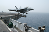 An F/a-18e Super Hornet Assigned To The  Eagles  Of Strike Fighter Squadron One One Five (vfa 115) Launches From The Flight Deck Aboard The Aircraft Carrier Uss Abraham Lincoln (cvn 72). Image