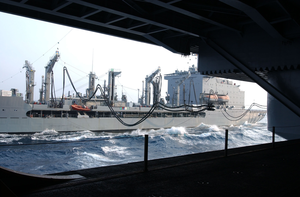 The Military Sealift Command Oiler Usns Kanawha (t-ao 196) Moves Fuel Lines Across Pulleys To Begin The First Underway Replenishment (unrep) With Uss Ronald Reagan (cvn 76) Image