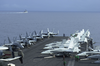 Aircraft From Carrier Air Wing Eleven (cvw-11) Are Chocked And Chained To The Forward Catapults Aboard Uss Nimitz (cvn 68) While The Guided Missile Cruiser Uss Princeton (cg 59) Sails By. Image
