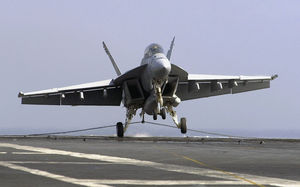 An F/a-18f Super Hornet Makes An Arrested Landing On The Flight Deck Of Uss John C. Stennis (cvn 74). Image