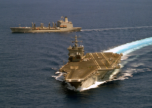 The Uss Enterprise (cvn 65) Pulls Away From The Military Sealift Command Fast Combat Support Ship Usns Leroy Grumman (t-ao 195) During An Emergency Breakaway Drill Image