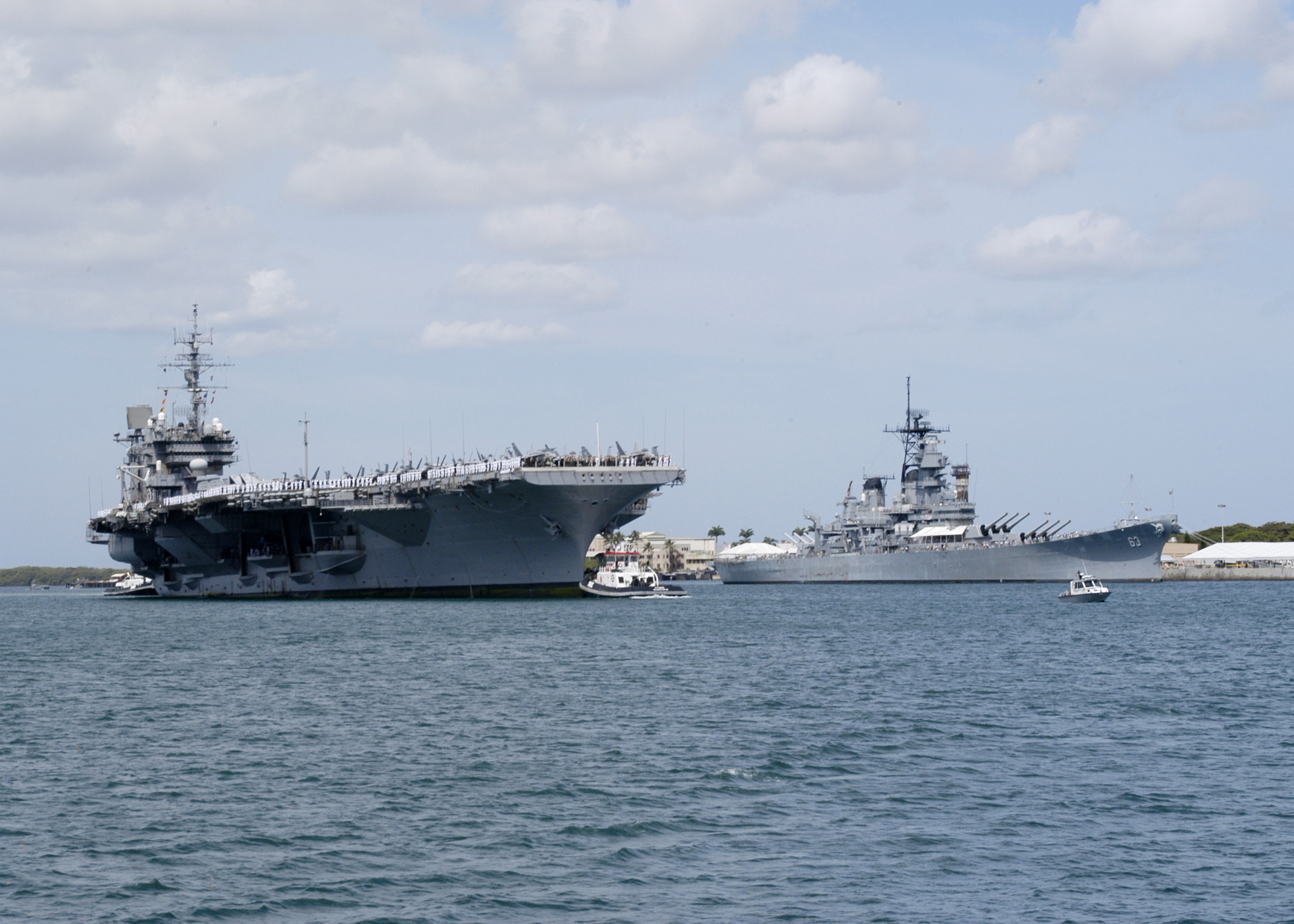 uss constellation  cv 64  sails past uss missouri  bb 63  as it makes a week