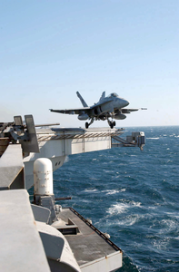 F/a-18 Hornet Launches From Uss Abraham Lincoln Cvn 72 Image