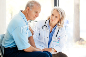 Stock Photo Sad Patient Being Recomforted By A Doctor Image