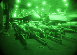 Ordnance Is Staged In The Hangar Bay Before Being Loaded Onto Aircraft On The Flight Deck Of The Uss Constellation (cv 64). Image