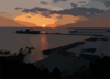 The 7th Fleet Command And Control Ship Uss Blue Ridge (lcc 19) Sits Moored In Port As The Sun Sets At U.s. Naval Facility White Beach, Okinawa, Japan. Clip Art