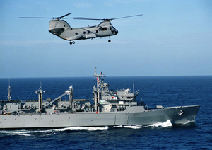A Ch-46 Sea Knight Assigned To The  Gunbearers  Of Helicopter Combat Support Squadron One One (hc-11), Detachment One, Flies Alongside The Fast Combat Support Ship Uss Rainier (aoe 7). Image