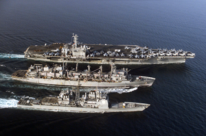 The Aircraft Carrier Uss Nimitz (cvn 68), Guided Missile Cruiser Uss Princeton (cg 59), And Fast Combat Support Ship Uss Bridge (aoe 10) Participate In An Underway Replenishment (unrep). Image