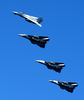 F-14dtomcats Fly Over The Deck Of Uss John C. Stennis (cvn 74) Image