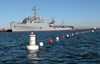A Newly Installed Buoy-based Security Barrier Stretches Around The Amphibious Transport Dock Ship Uss Denver (lpd 9) As The Ship Takes On Ammunition. Image