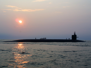 The Ballistic Missile Submarine Uss Rhode Island (ssbn 740) Cruises Through The Atlantic Ocean As Crewmembers Work Up On Deck Image