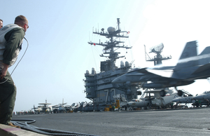 Air Wing Lso Monitors F/a-18 Carrier Landing. Image