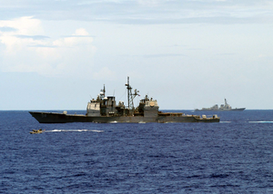 The Guided Missile Cruiser Uss Antietam (cg 54) And The Guided Missile Destroyer Uss Lassen (ddg 82) Conduct A Small Boat Exercise With The Guided Missile Frigate Uss Ingraham (ffg 61) Image