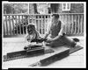 [j.n. Swartzell And Daughter Margaret Seated With Parts Of Electric Train, On Porch Of Home, Washington, D.c.] Image