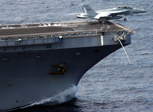 A F/a-18f Super Hornet Launches From The Bow Of Uss John C. Stennis (cvn 74). Image
