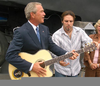 Bush Playing Guitar Image