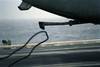 An Arresting Wire Falls Away From An S-3b Viking Image