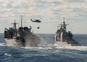 The Military Sealift Command Ship Usns Supply (t-aoe 6) Conducts A Refueling At Sea And Vertical Replenishment At Sea Image