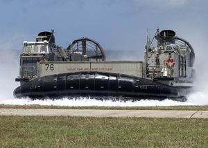 A Landing Craft Air Cushion (lcac) Comes Ashore At U.s. Naval Forces Marianas Island Image