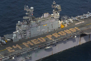 Marines Assigned To The 24th Marine Expeditionary Unit (meu) Embarked Aboard The Amphibious Assault Ship Uss Nassau (lha 4), Create Formation Lettering On The Ship S Flight Deck Spelling Out 24 Meu Proud! Image