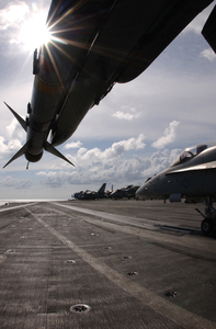 An F/a-18c  Hornet  Loaded With The Aim-9m  Sidewinder  Missile Rests On The Flight Deck Off Uss Kitty Hawk (cv 63) Image