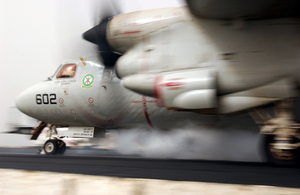 An E-2c Hawkeye Prepares To Launch From The Flight Deck Aboard The Aircraft Carrier Uss Kitty Hawk (cv 63), While A Sandstorm Blows Across The Arabian Gulf Region Image