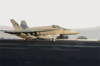 An F/a-18c Assigned To The  Golden Dragons  Of Strike Fighter Squadron One Ninety Two (vfa-192) Launches Off One Of Four Steam-powered Catapults On The Flight Deck Of Uss Kitty Hawk (cv 63). Clip Art