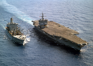 The Uss Enterprise (cvn 65) Steams Alongside The Military Sealift Command Fast Combat Support Ship Usns Leroy Grumman (t-ao 195) During An Underway Replenishment (unrep) Image