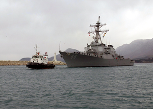 A Tug Boat Leads The U.s. Navy Guided Missile Destroyer Uss Gonzalez (ddg 66) Into Port Image
