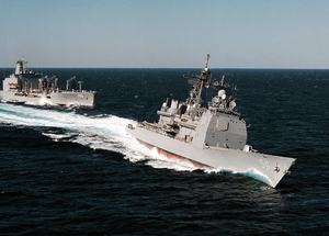U.s. Navy S Ticonderoga Class Cruiser Uss San Jacinto (cg 56) (center) Executes A High-speed Break Away Following Replenishment At Sea (ras) Operations With The Military Sealift Command Replenishment Oiler Usns Big Horn (t-ao 198) Image
