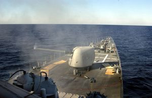 Smoke Is Released From The Barrel Of The Ship S Mk-45 Five Inch Gun Mount During A Live Fire Exercise Image