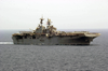 The Amphibious Assault Ship Uss Iwo Jima (lhd 7) Cruises Alongside Uss Nimitz (cvn 68) Image