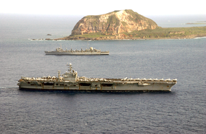 The Nuclear Powered Aircraft Carrier Uss Carl Vinson (cvn 70) And The Fast Combat Support Ship Uss Sacramento (aoe 1) Pass Mount Suribachi On The Island Of Iwo Jima. Image