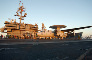 An E-2c Hawkeye Moves Into Position For Launch From One Of Four Steam Driven Catapults Image