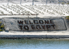 Welcome To Egypt Is Clearly Marked To Show That The Suez Canal Offers Safe Passage To Those Who Transit The Waterway, Which Is Used Daily By A Variety Of Ships, From Commercial Vessels To Military Warships. Image